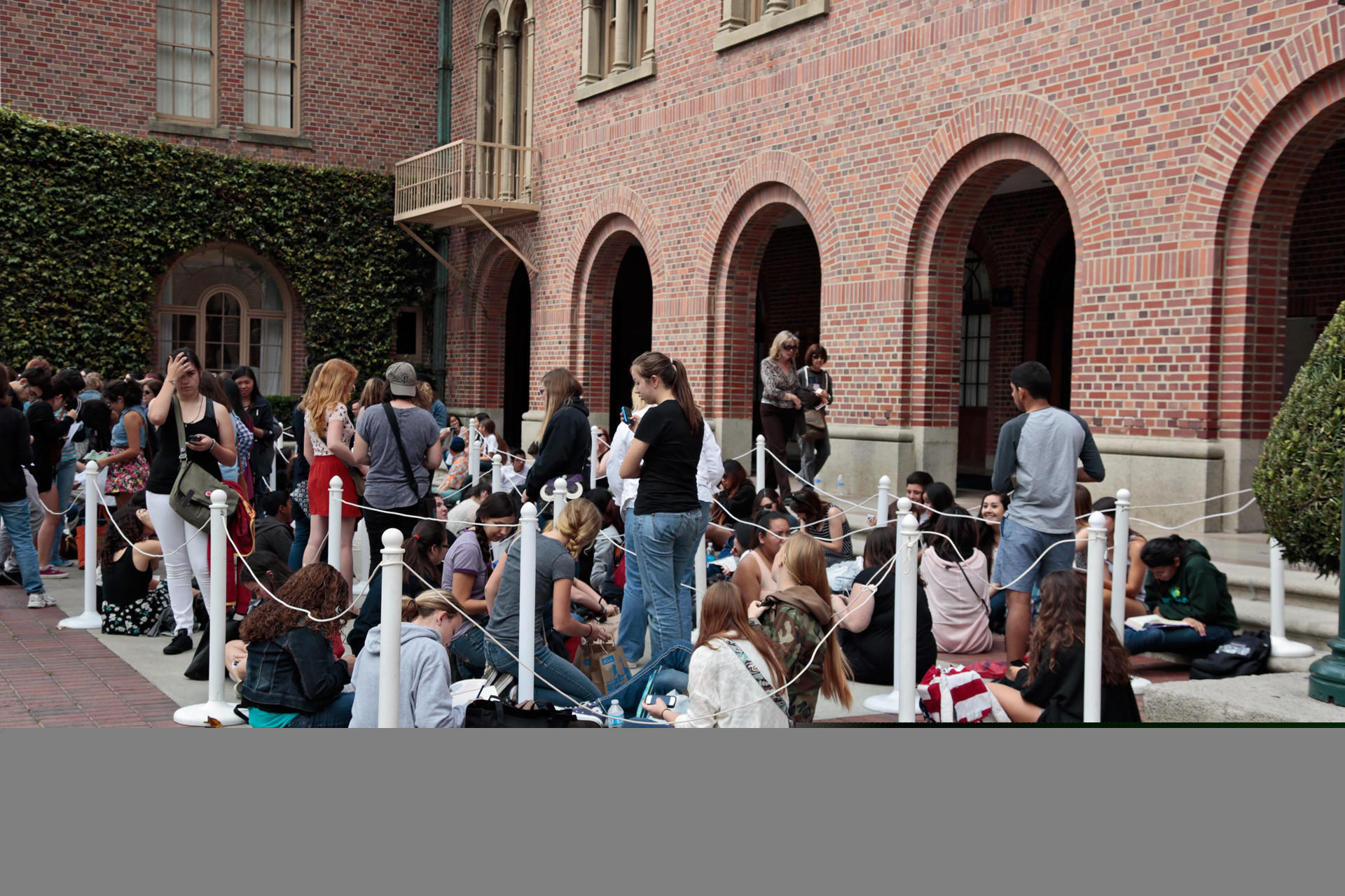 Fans line up early Saturday for a Festival of Books session with author John Green.