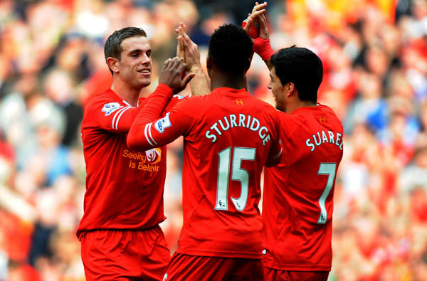 Liverpool's Jordan Henderson, left, is congratulated by teammates Daniel Sturridge and Luis Suarez after scoring a goal against Tottenham. The Reds have plenty to cheer about in leading the English Premier League standings if not in star power.