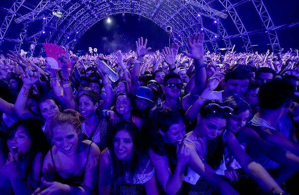 Fans of Zedd, the producer and DJ, vibrate to his performance at the Coachella Valley Music and Arts Festival in Indio on Friday.