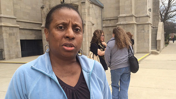 Tonya Burch speaking outside St. Sabina Catholic church Sunday after a meeting involving police, prosecutors and community members to discuss unsolved murders.
