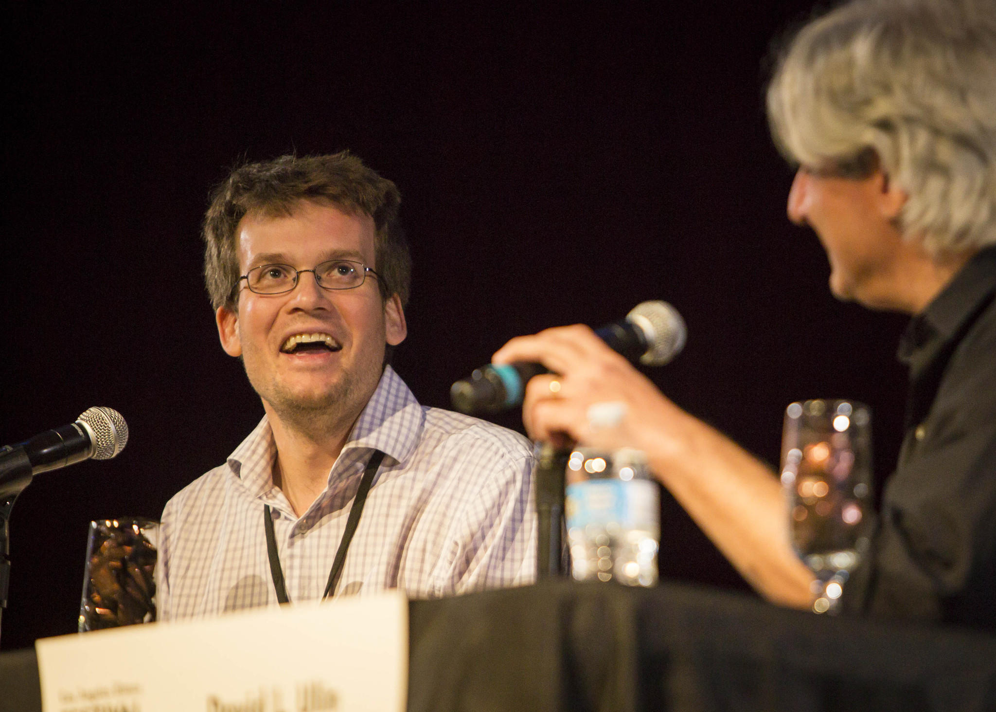 John Green, left, speaks Saturday with L.A. Times writer David Ulin at the Festival of Books.