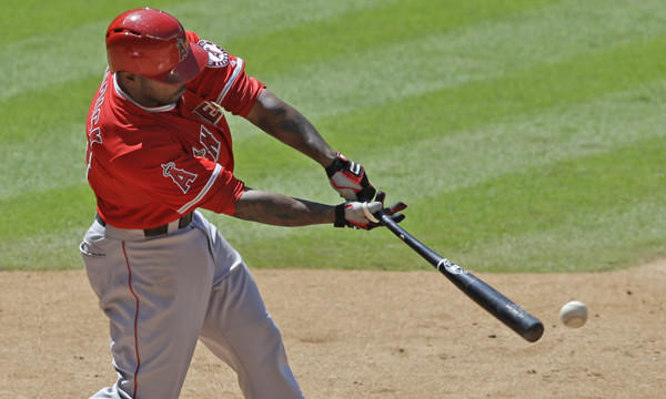 Angels second baseman Howie Kendrick hits a run-scoring single in a win over the Houston Astros on Monday.