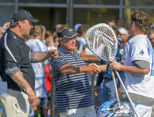 Hopkins head coach Dave Pietramala (left) introduces Johns Hopkins' Will Ryan (right) to New England Patriots head coach Bill Belichick afterJohns Hopkins defeated Maryland 11-6.