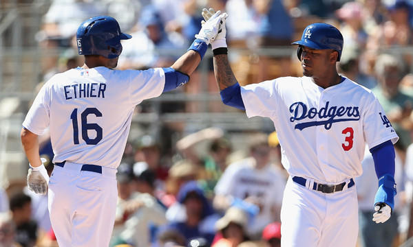 Dodgers outfielder Andre Ethier, left, celebrates with teammate Carl Crawford after hitting a three-run home run against the Oakland Athletics in spring training on March 10. Both players did not start in Saturday's game against the Arizona Diamondbacks.