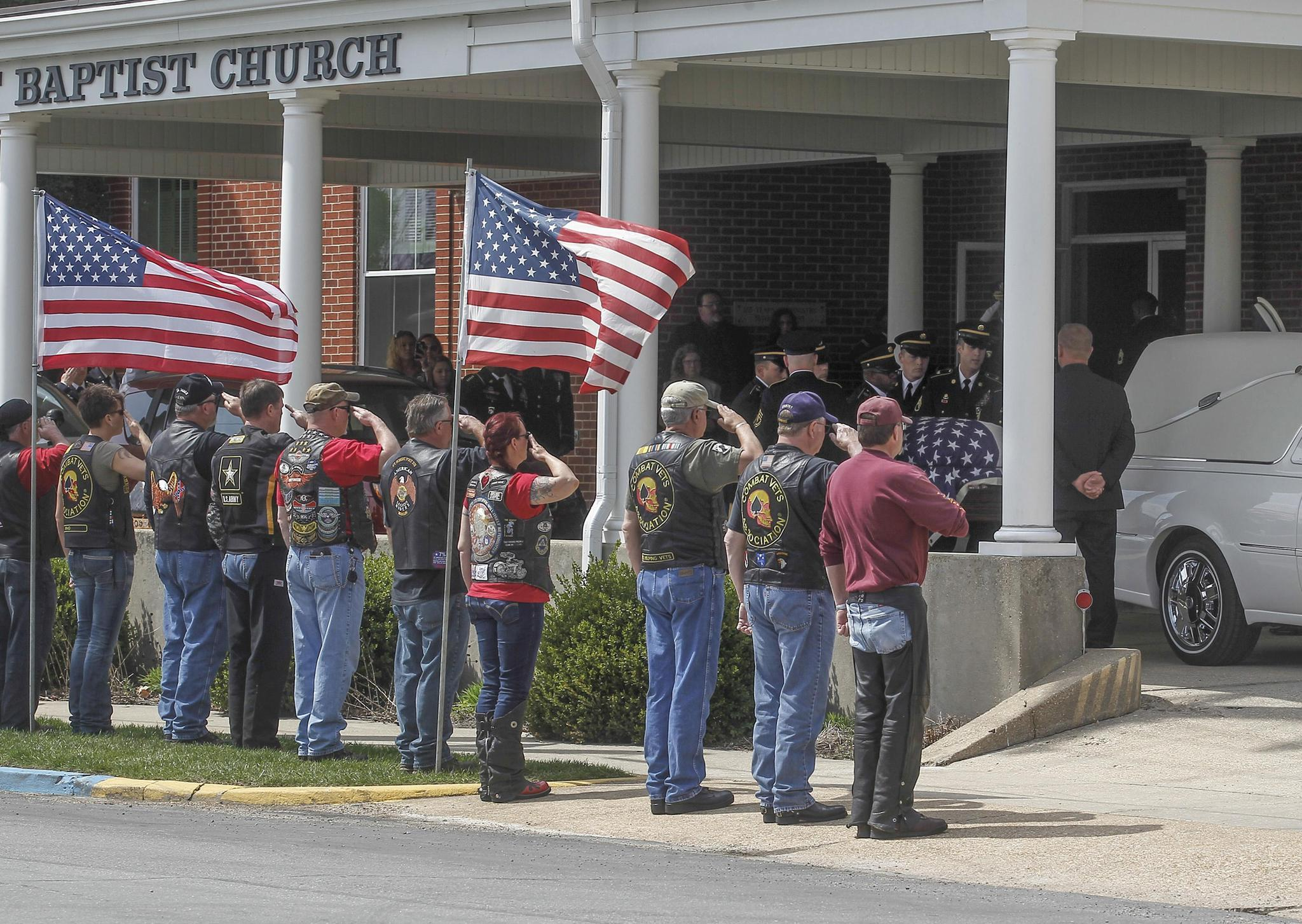 Members of the Patriot Guard Riders motorcycle club salute the casket outside the First Baptist Church after a private funeral service for Timothy Owens, 37, in Rolla, Missouri. Owens was one of three U.S. soldiers killed by Army Specialist Ivan Lopez in a shooting rampage at the Fort Hood Army base earlier this month.