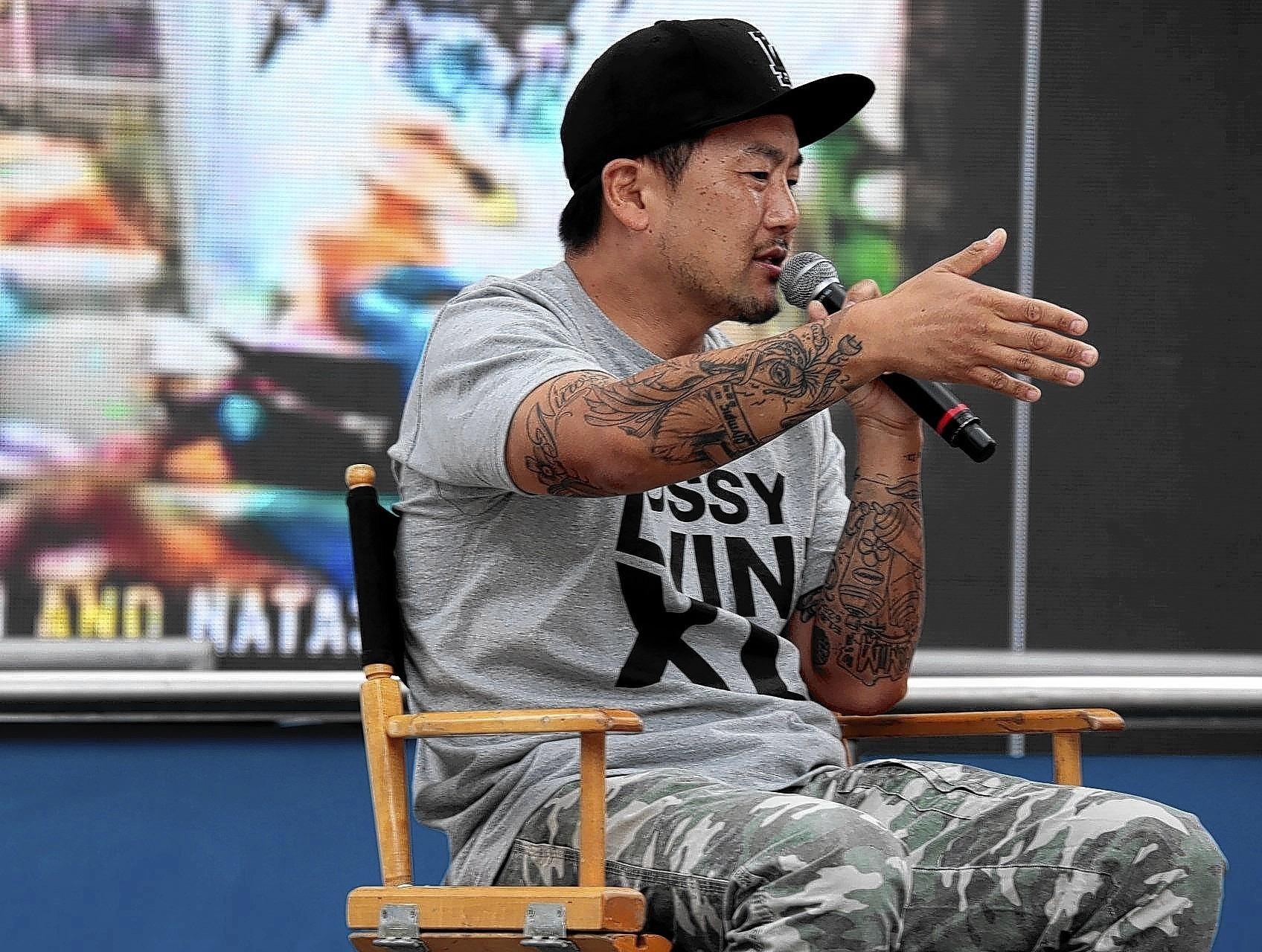 Roy Choi, of Kogi truck fame, talks to the crowd at the L.A. Times Festival of Books. Choi has always insisted he is a cook for the people and that his trucks offer up his ode to Los Angeles.