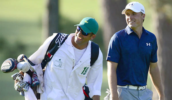 Masters co-leader Jordan Spieth, left, and caddie Michael Greller smile at golfer Adam Scott as they walk up the 15th fairway Saturday during the third round at the Masters in Augusta, Ga.