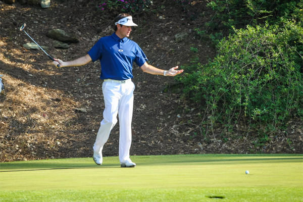 Bubba Watson reacts after a putt on the 12th hole Saturday at the Masters in Augusta, Ga.