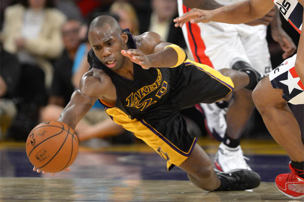 Jodie Meeks dives for a loose ball during a Lakers' loss to Washington back in March.