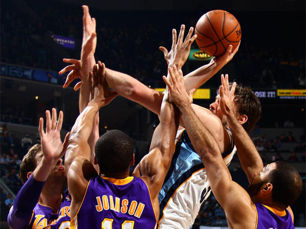 Memphis' Marc Gasol tries to create room against a triple-team by the Lakers' Pau Gasol, left, Wesley Johnson and Kendall Marshall on Feb. 26.