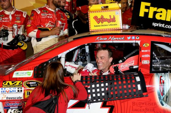 evin Harvick, driver of the #4 Budweiser Chevrolet, celebrates in Victory Lane after winning the NASCAR Sprint Cup Series Bojangles' Southern 500 at Darlington Raceway on April 12, 2014 in Darlington, South Carolina.