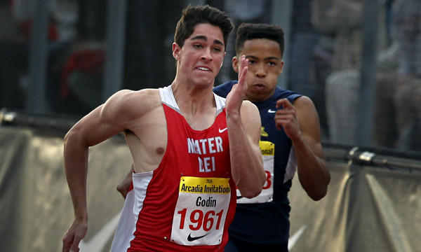 Mater Dei's Curtis Godin, left, speeds past Santa Monica's Marcel Espinoza on his way to winning the boys' 100 meters Saturday at the Arcadia Invitational.