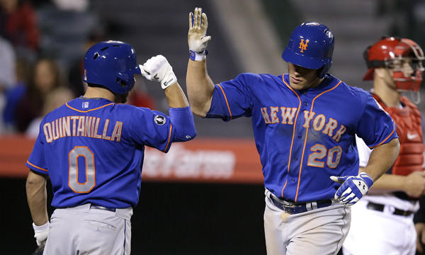 New York Mets' Anthony Recker, right, celebrates with teammate Omar Quintanilla after hitting a solo home run in the 13th inning of the Angels' 7-6 loss Saturday night.