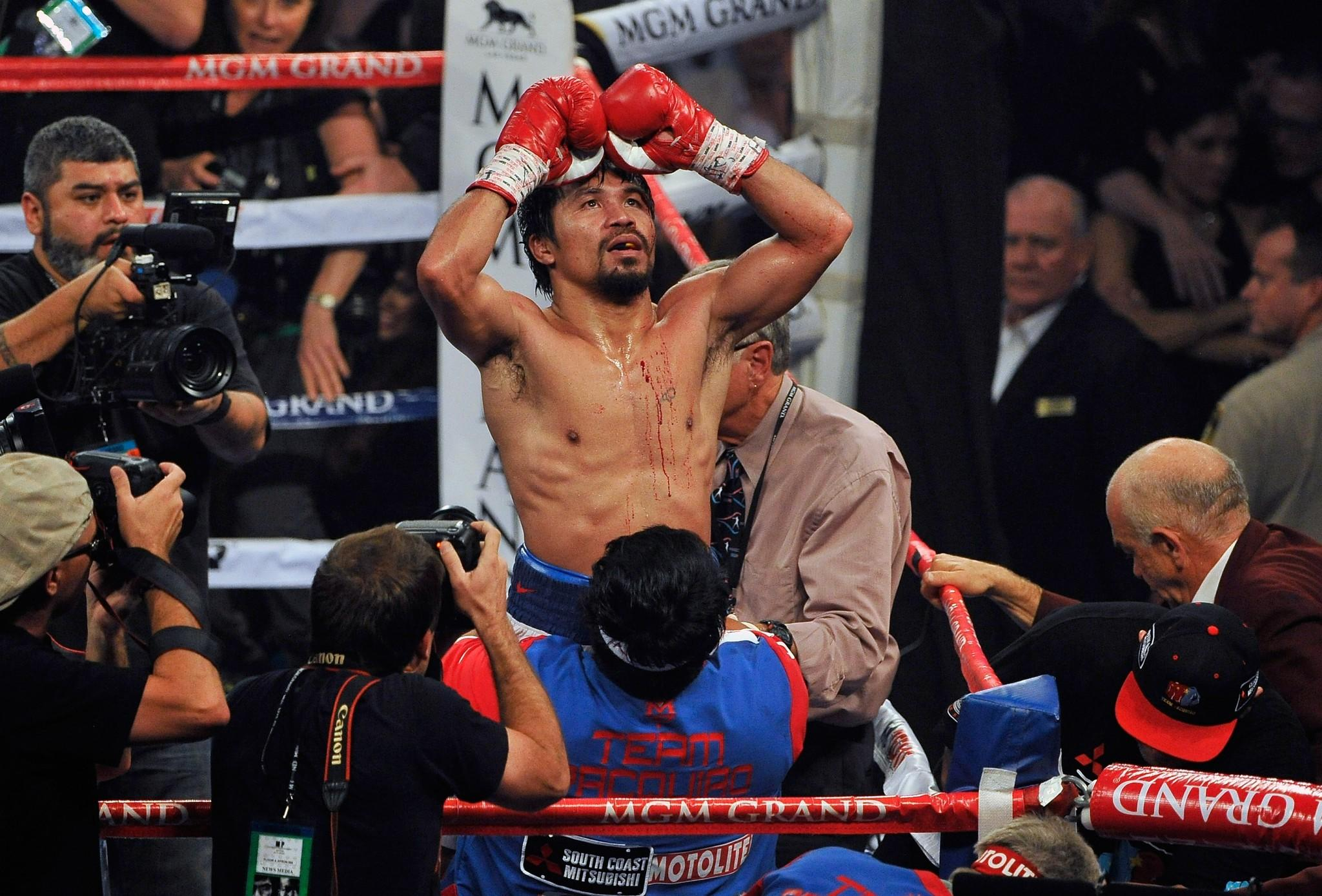 Manny Pacquiao celebrates after his unanimous decision victory over Timothy Bradley in their WBO welterweight championship match Saturday at the MGM Grand Garden Arena.