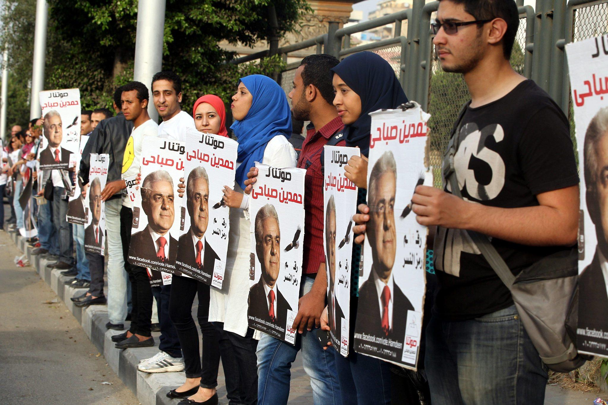 Supporters of Egyptian presidential hopeful Hamdin Sabahi hold up his campaign posters during a demonstration in Cairo.