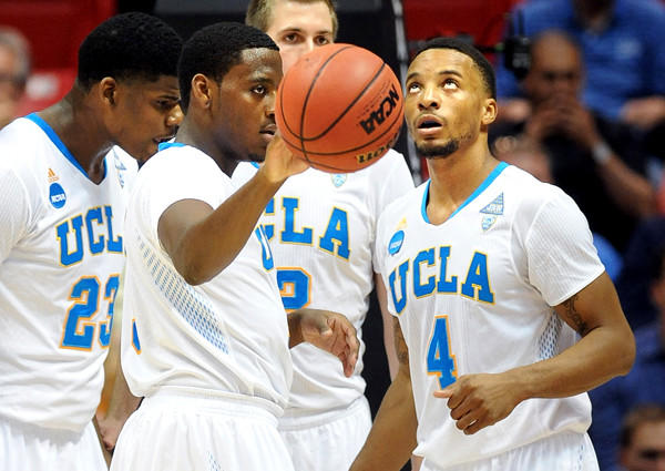Bruins guards Jordan Adams (with ball) and Norman Powell (4) combined for nearly 29 points a game last season.