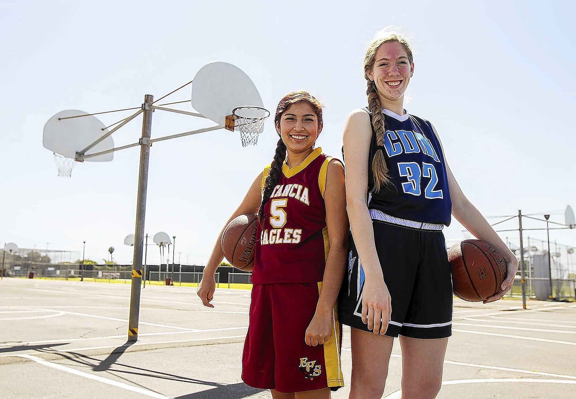 Estancia senior Celia Duran and Corona del Mar sophomore Natalia Bruening share the Daily Pilot Dream Team Player of the Year award in girls' basketball.