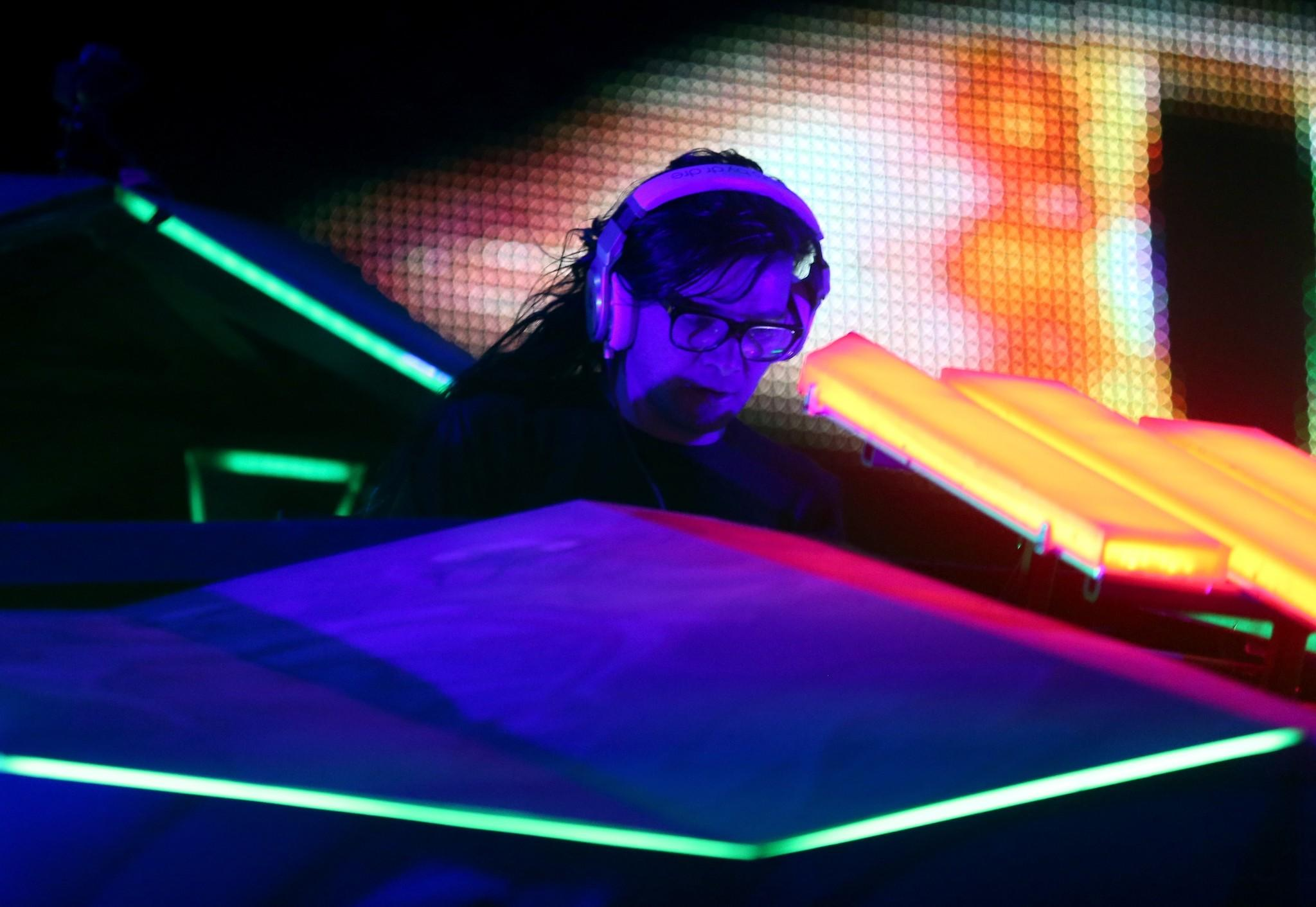 Skrillex performs onstage during day 2 of the 2014 Coachella Valley Music & Arts Festival.