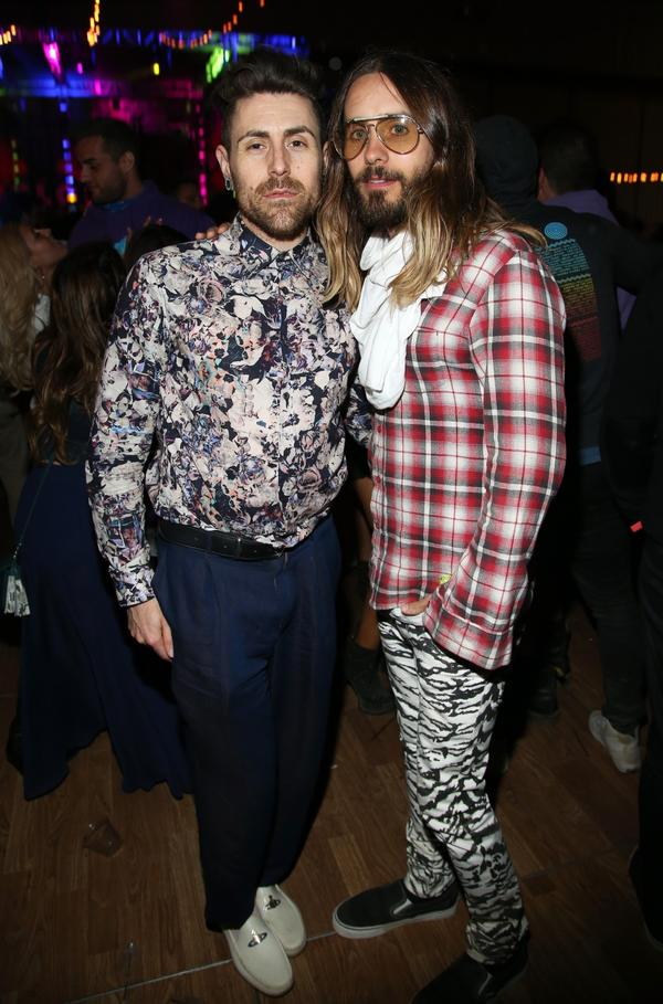 Jared Leto, right, and a guest attend Neon Carnival in Thermal, Calif., on Saturday night.
