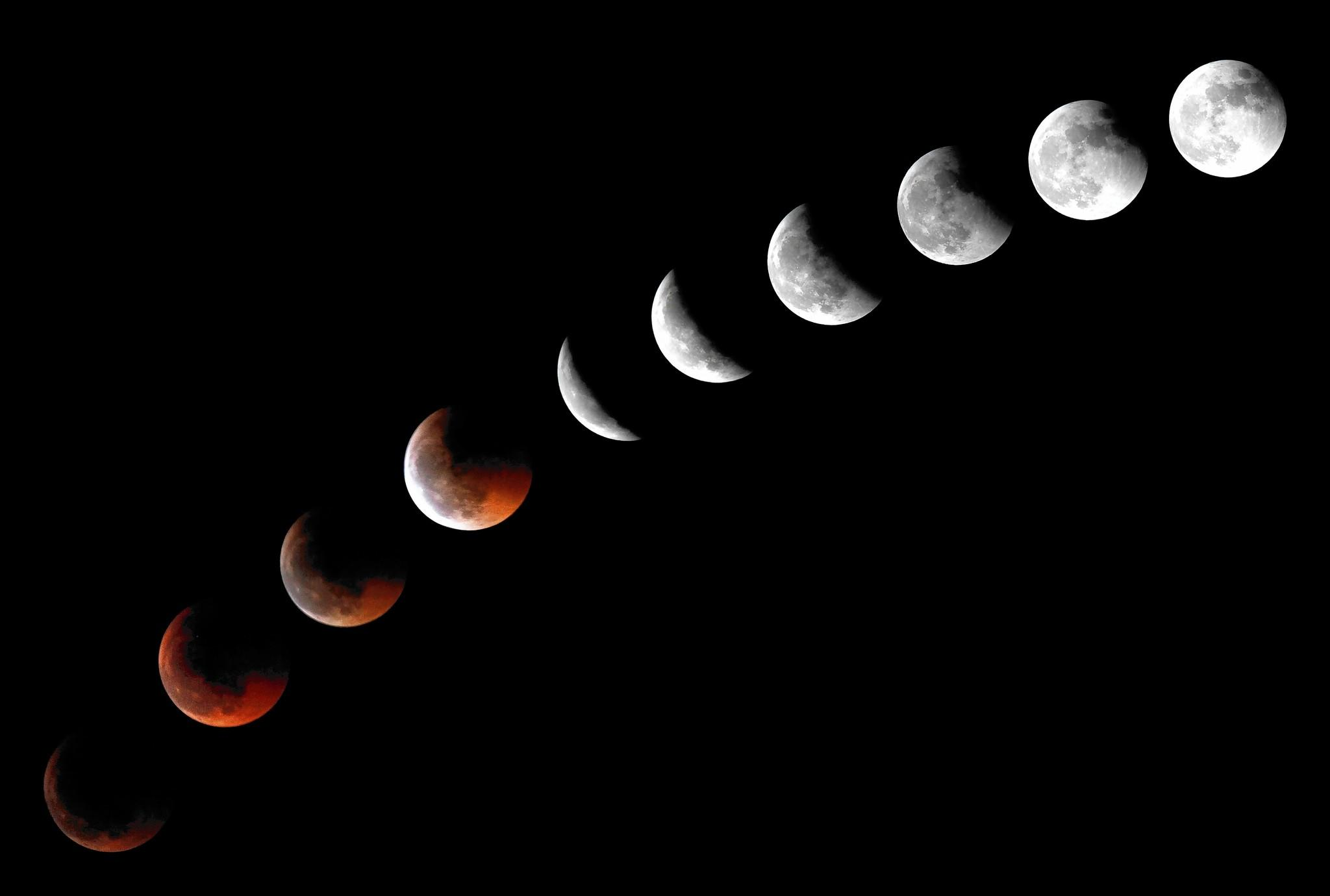 This combination of 10 pictures put together in PhotoShop and taken in the National Park of the volcano Teide shows the moon during a total lunar eclipse, on the Spanish Canary Island of Tenerife.