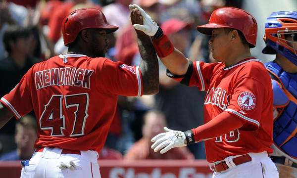 Angels catcher Hank Conger, right, is congratulated by teammate Howie Kendrick after hitting a two-run home run during the fifth inning of the Angels' 14-2 victory over the New York Mets on Sunday.