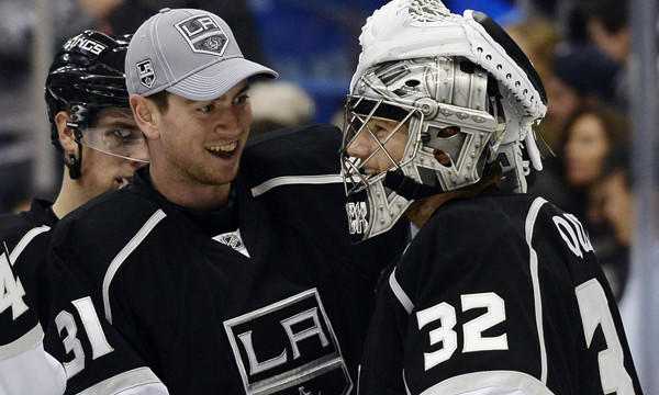 Kings backup goalie Martin Jones, left, congratulates goalie Jonathan Quick following a 4-2 win over the Winnipeg Jets. Quick won the William M. Jennings Trophy outright on Sunday.