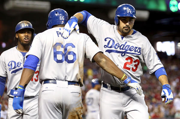 Dodgers first baseman Adrian Gonzalez (23) celebrates with teammates Yasiel Puig (66) and Hanley Ramirez after hitting a three-run home run against the Diamondbacks in the fourth inning Sunday afternoon in Phoenix.