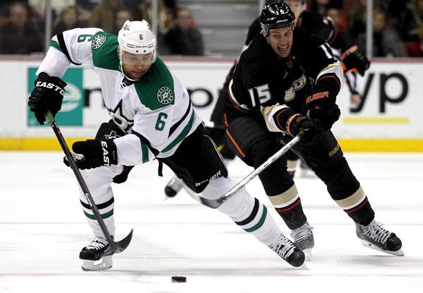 Ducks captain Ryan Getzlaf (15) battles Stars defenseman Trevor Daley (6) for possession of the puck during a game earlier this season at Honda Center.