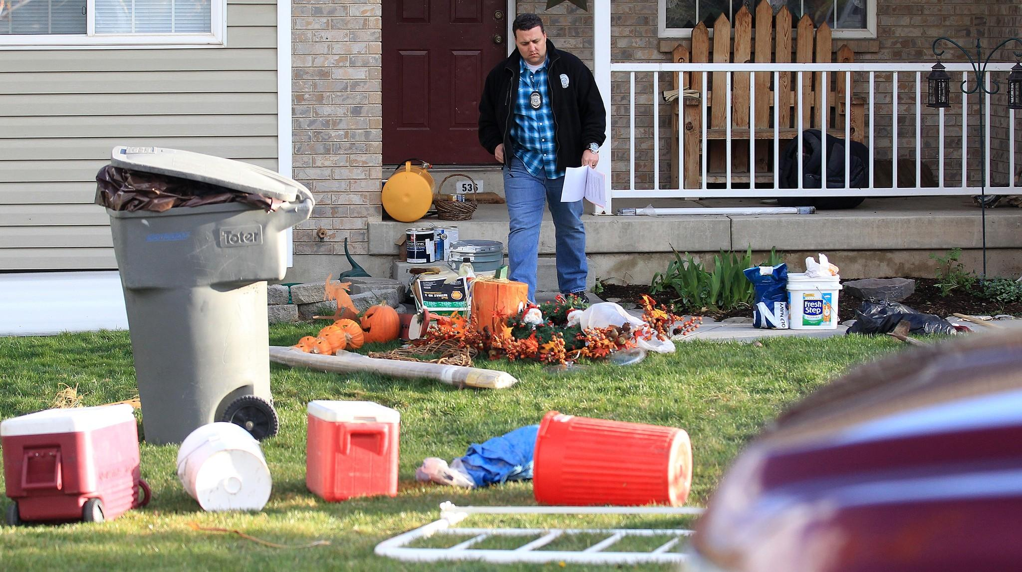 Police in Pleasant Grove, Utah, at a home where the bodies of seven infants were discovered.