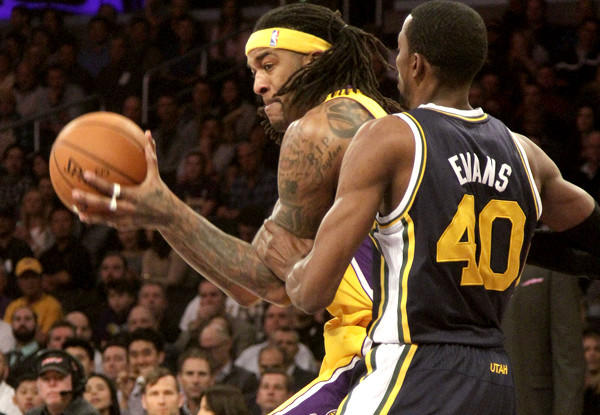 Lakers power forward Jordan Hill works in the post against Jazz forward Jeremy Evans during a game earlier this season at Staples Center.