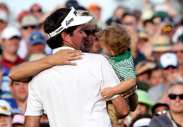 Bubba Watson celebrates with wife Angie and son Caleb next to the 18th green after winning the Masters tournament on Sunday at Augusta National Golf Club.