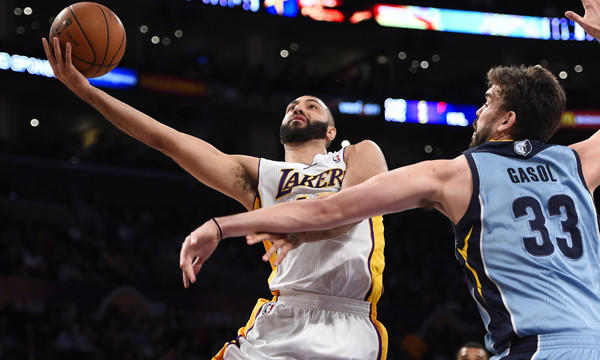 Lakers point guard Kendall Marshall, left, puts up a shot in front of Memphis Grizzlies center Marc Gasol during the first half of Sunday's game at Staples Center.