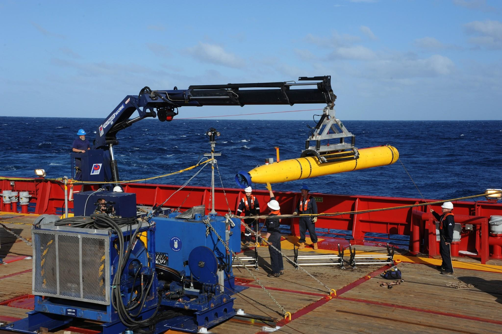 The Bluefin-21 underwater vehicle is hoisted back aboard the Australian ship Ocean Shield after successful buoyancy testing in the Indian Ocean.