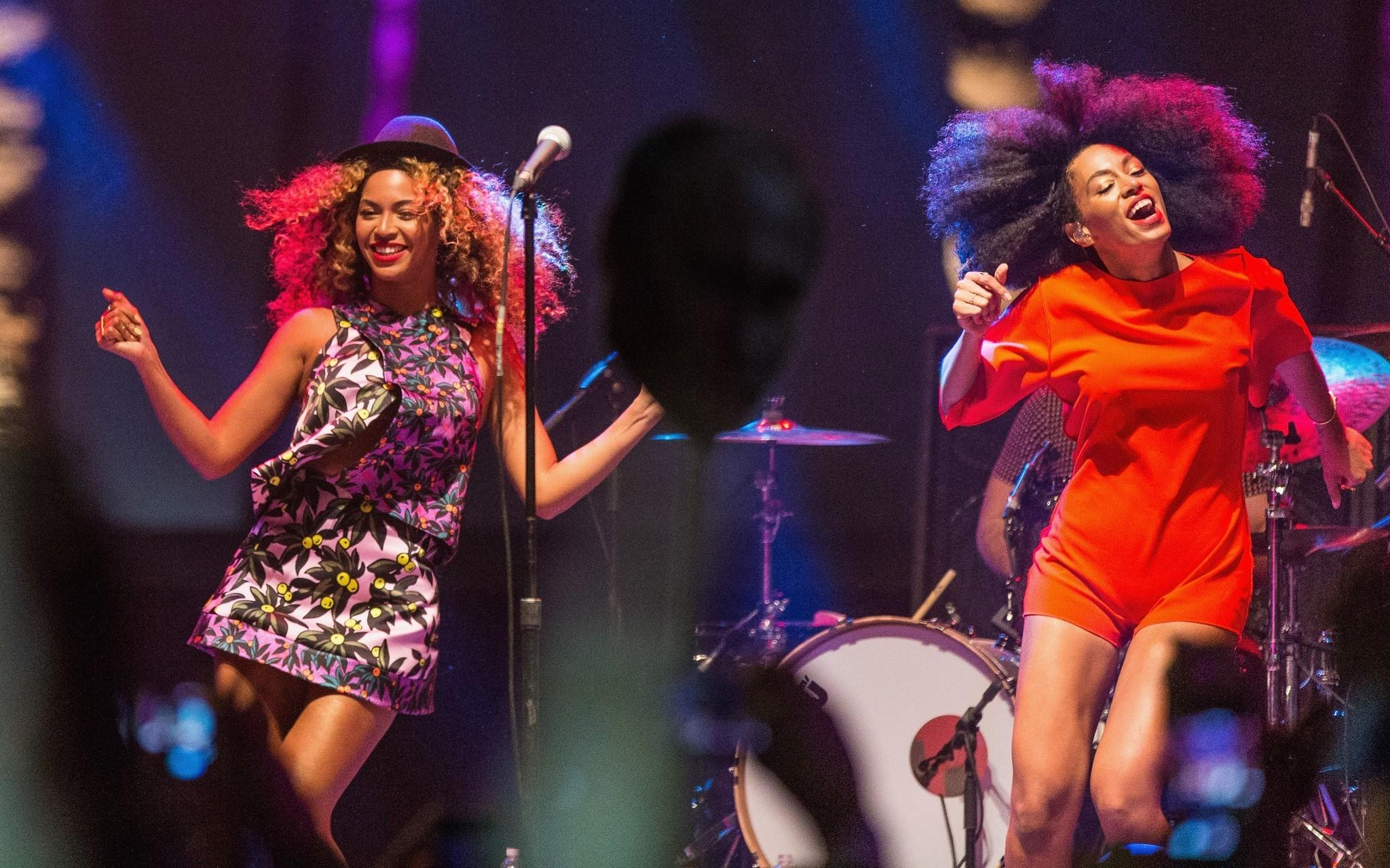Beyonce, left, performs with her sister Solange Knowles during Day 2 of the 2014 Coachella Valley Music & Arts Festival at the Empire Polo Club in Indio, Calif.