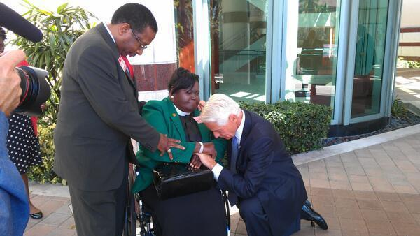 Before West Palm speech former Gov. Charlie Crist spots Rev. Edrena Brown of Mt. Herman AME Church (center) and asks her to pray with him. Democratic candidate for state Agriculture Commissioner Thaddeus Hamilton is at left. (Photo by Anthony Man)