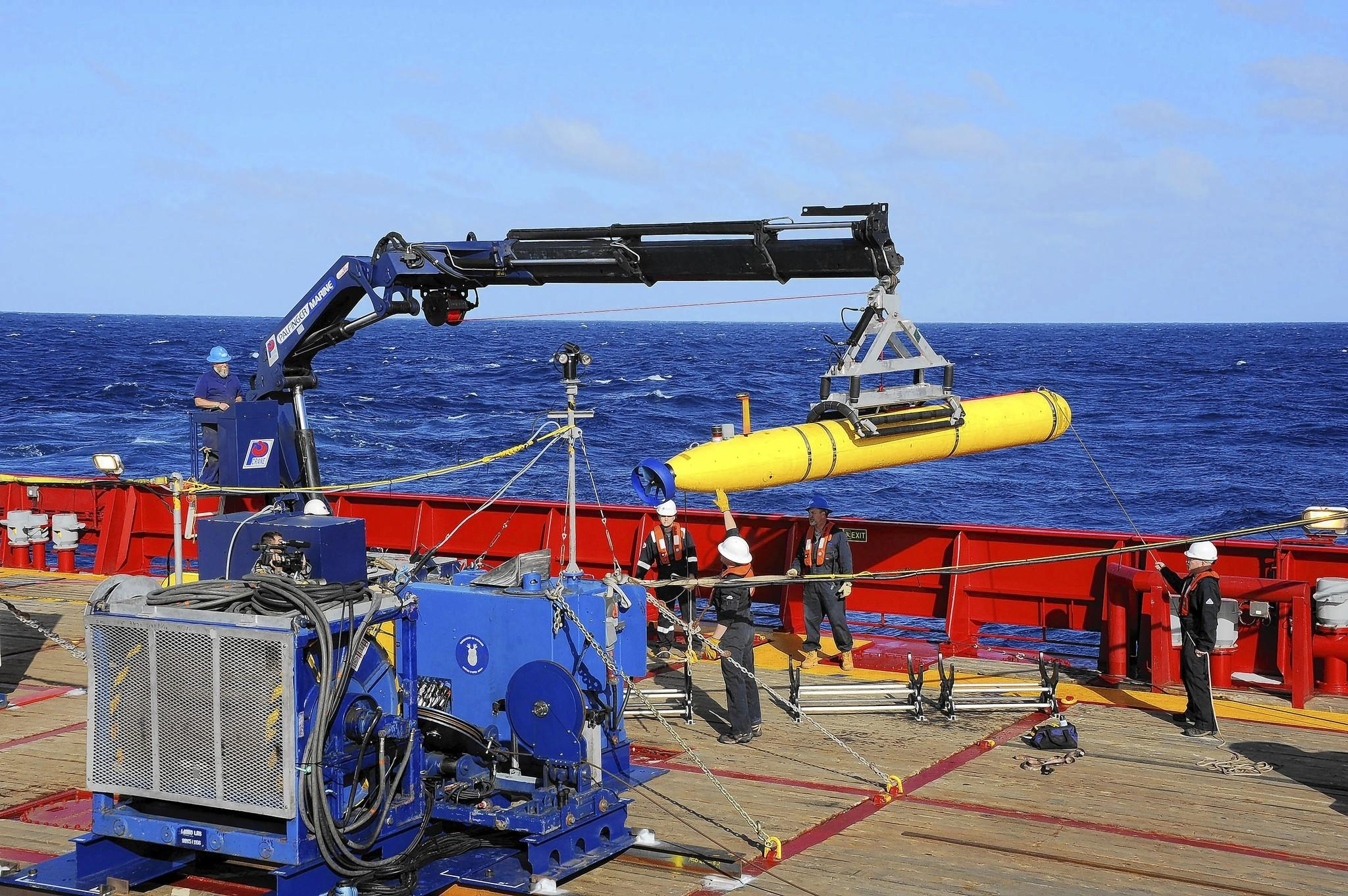 The Bluefin-21 autonomous underwater vehicle is hoisted back onto the Australian ship Ocean Shield after buoyancy testing in the Indian Ocean. The robotic submarine with side-scanning radar will soon search the seabed for wreckage from the missing Malaysia Airlines Flight 370.