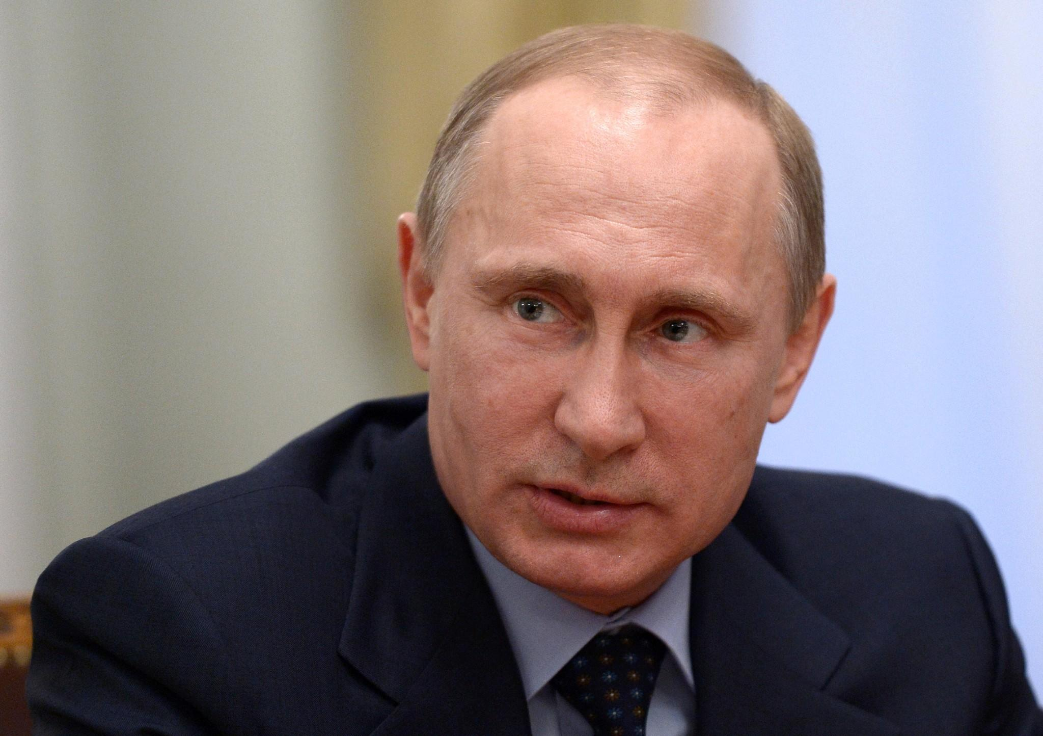 Russian President Vladimir Putin speaks during a meeting at the Novo-Ogaryovo residence outside Moscow, Russia.