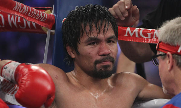 Manny Pacquiao sits in his corner with trainer Freddie Roach, right, during his WBO welterweight title victory over Timothy Bradley on Saturday.
