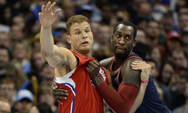 Clippers forward Blake Griffin and Denver Nuggets center J.J. Hickson battle for position during the Clippers' loss on March 17.