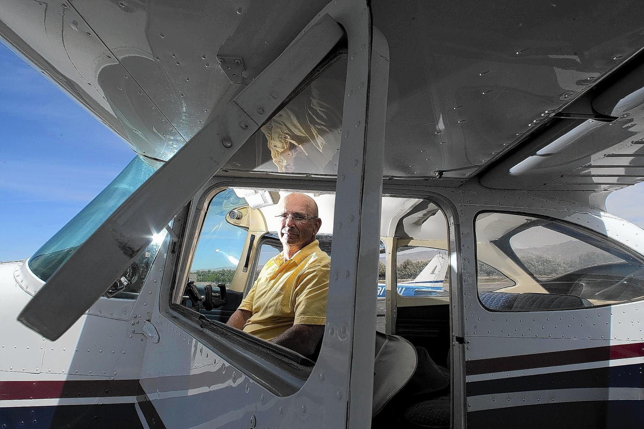 Ken Dobson, a retired police officer, sits in his single-engine Cessna at Bermuda Dunes Airport in California. He was detained and his plane searched by federal agents -- without legal justification -- after he landed at a small airport in Detroit. Instead of uncovering a drug cache, the officials found luggage, golf clubs and an empty Thermos.