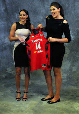 UConn players Bria Hartley, left, and Stefanie Dolson pose for a photo with their new team jersey after the draft. The Washington Mystics picked Dolson sixth, then acquired Hartley from the Seattle Storm, who picked her seventh.