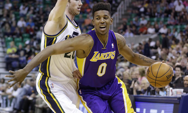 Lakers small forward Nick Young, right, drives around Utah Jazz guard Gordon Hayward during their game in Salt Lake City.