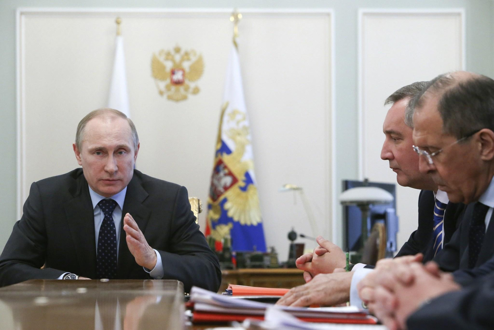 Russia's President Vladimir Putin attends a meeting with members of the government at the Novo-Ogaryovo state residence outside Moscow.