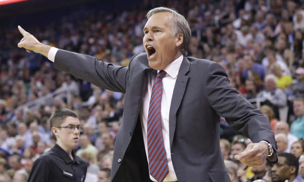 Lakers Coach Mike D'Antoni reacts to a call during the second half of the team's 119-104 win over the Utah Jazz on Monday. Are the Lakers planning to keep D'Antoni for the 2014-15 season?