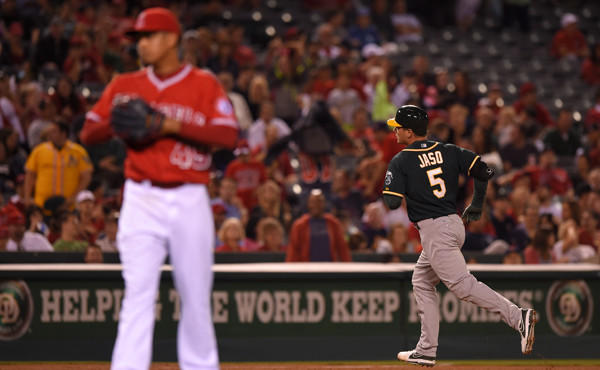 Oakland Athletics pinch hitter John Jaso, right, rounds third after hitting a two-run home run off Angels closer Ernesto Frieri, left, during the ninth inning of the Angels' 3-2 loss Monday.