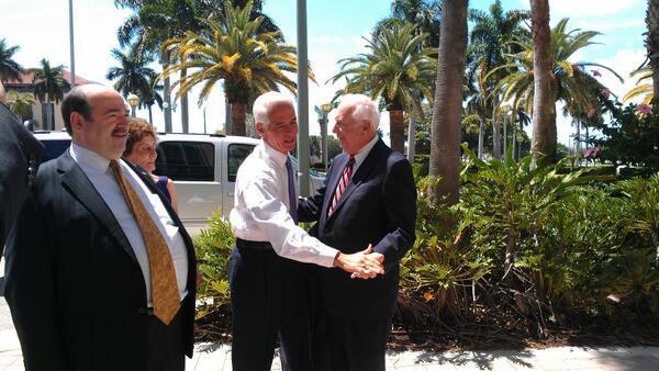 Former Gov. CharlieCrist greets former Palm Beach County Commissioner Burt Aaronson before a speech in West Palm Beach. Former Sen. Steve Geller at left. (Photo by Anthony Man)