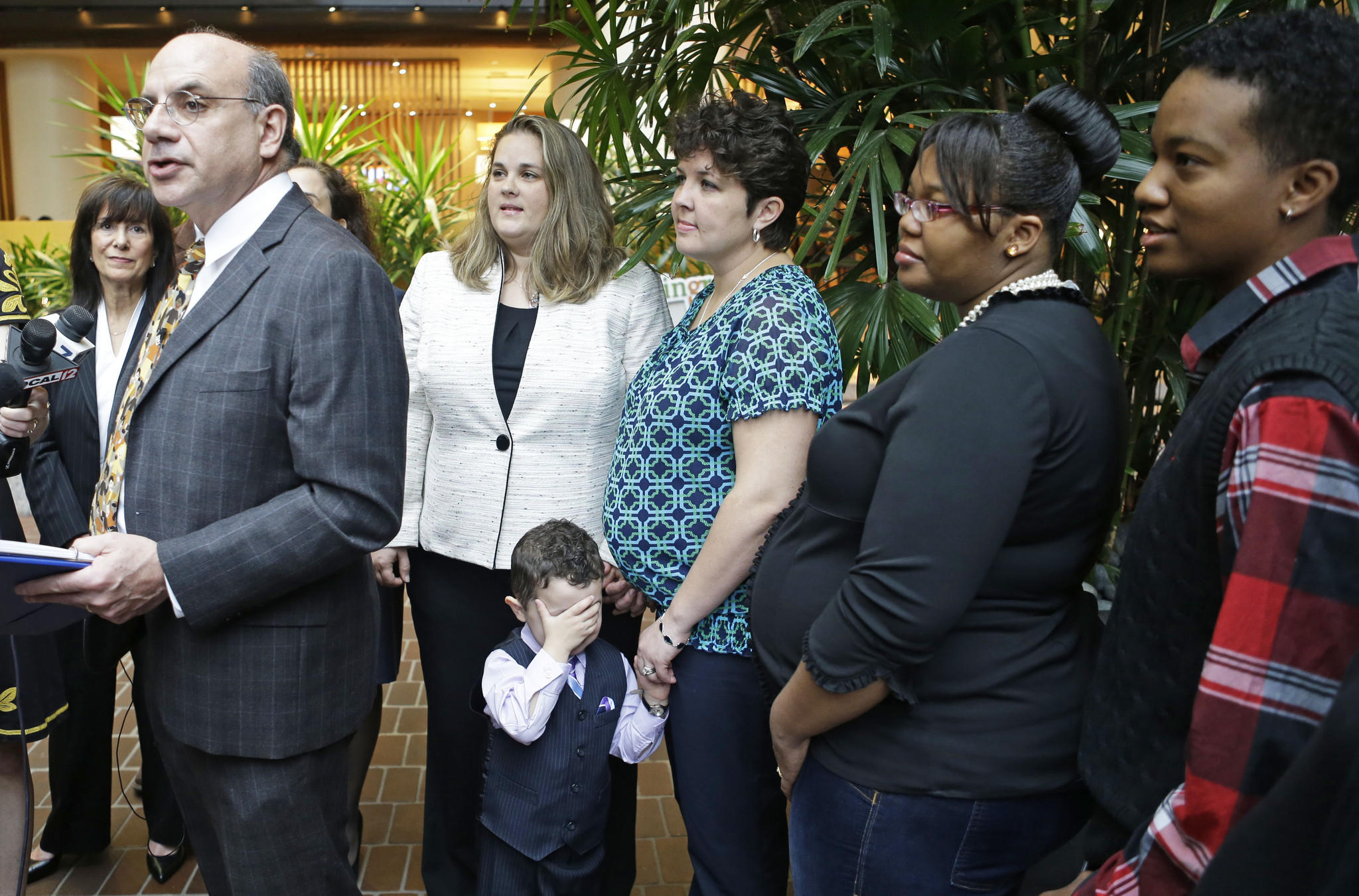 Attorney Al Gerhardstein, left, stands with several same-sex couples at an April 4 news conference in Cincinnati.