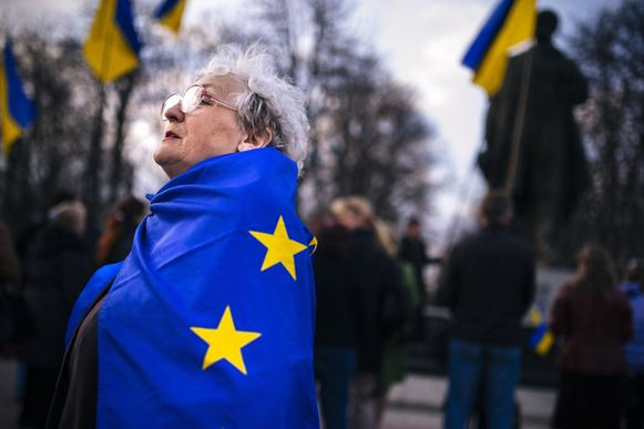 A woman wrapped in a European Union flag attends a pro-Ukraine rally in the eastern Ukrainian city of Lugansk.