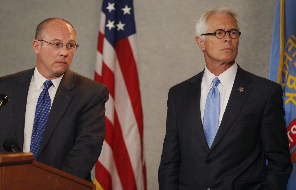 Johnson County, Kansas, Dist. Atty. Steve Howe, left, and U.S. Attorney Barry Grissom at a news conference Tuesday about the killings in Overland Park on Sunday.