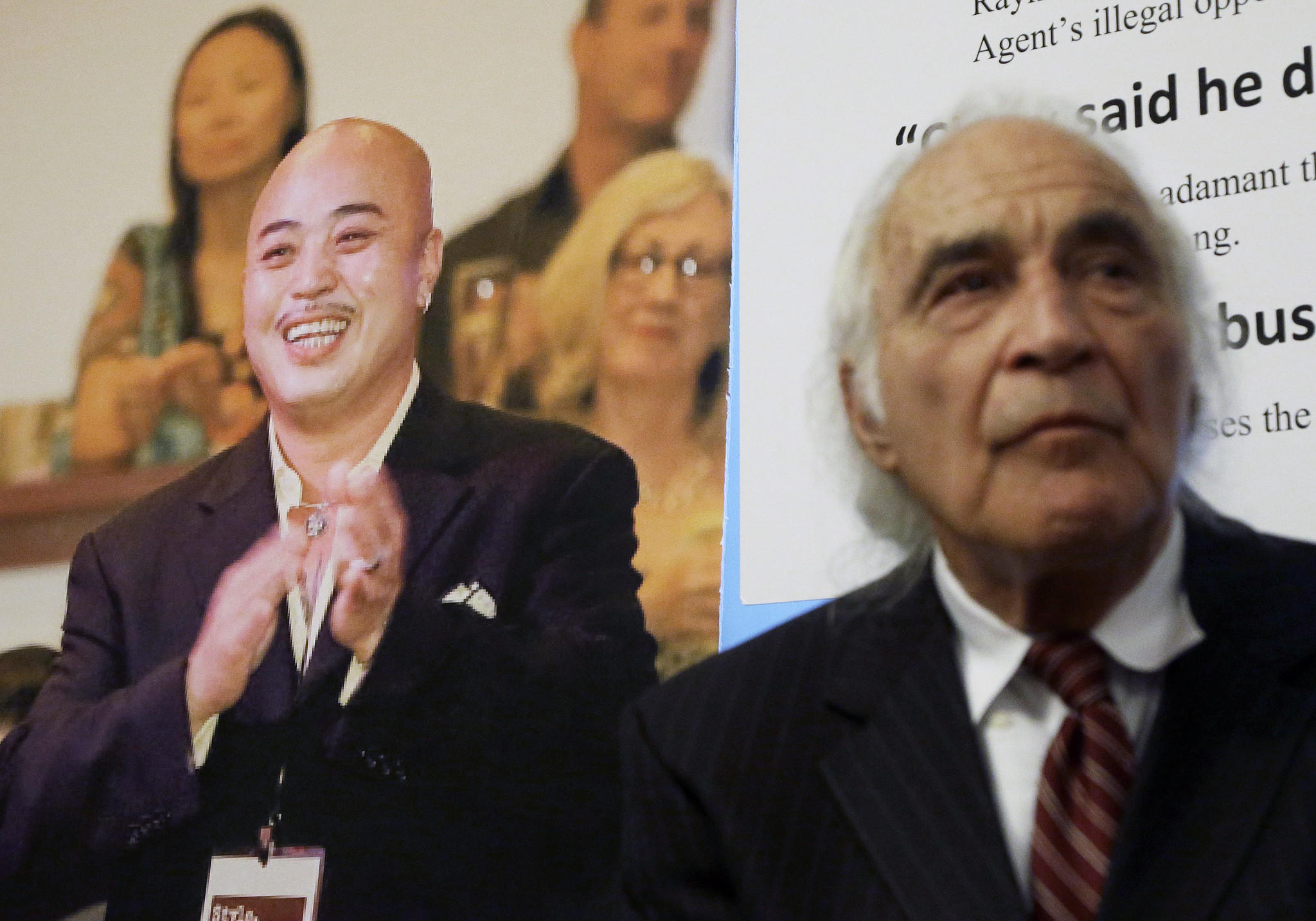 """Raymond """"Shrimp Boy"""" Chow, depicted at left, pleaded not guilty Tuesday to money laundering and other federal charges in San Francisco. At right is his attorney, J. Tony Serra."""